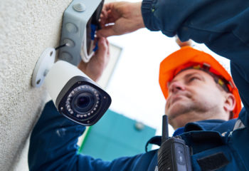 An electrician installing a CCTV