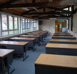 large classroom with screen desks installed