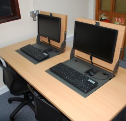 Versatile Flip screen installed into desks