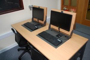 Versatile Flip screen installed into desks