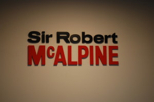 Sir Robert McAlpine banner on brown background