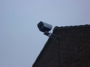 Installed CCTV camera outside the top of a wall
