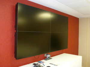 huge screen with red wall background