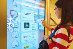 Woman using an interactive digital signage at a shopping mall