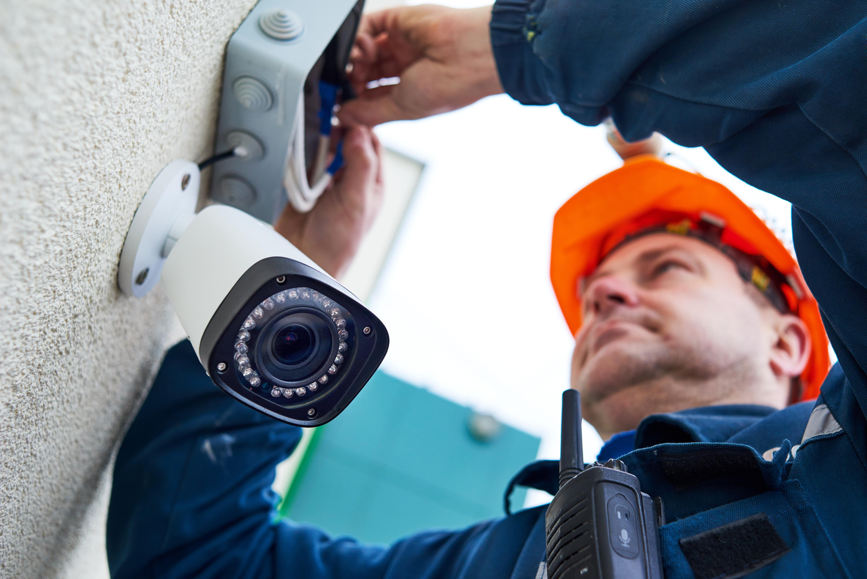 An electrician installing a CCTV